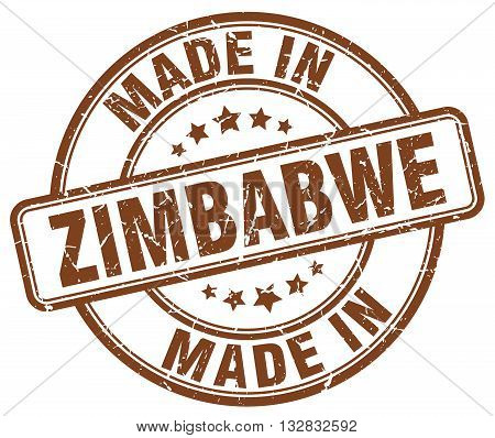 made in Zimbabwe brown round vintage stamp.Zimbabwe stamp.Zimbabwe seal.Zimbabwe tag.Zimbabwe.Zimbabwe sign.Zimbabwe.Zimbabwe label.stamp.made.in.made in.