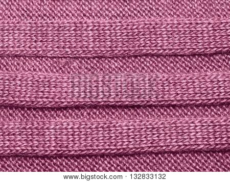 Pink ribbed knit wool like texture textured fabrics knitted jersey wool as a background pattern upholstery