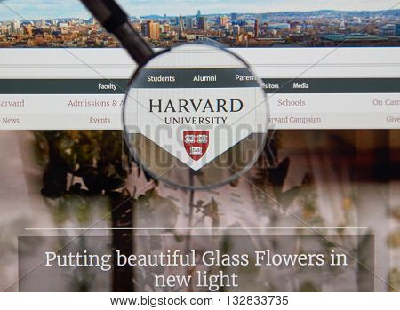 MONTREAL CANADA - JUNE 4 2016 : Harvard University page under magnifying glass. Harvard University is a private research university in Cambridge Massachusetts.