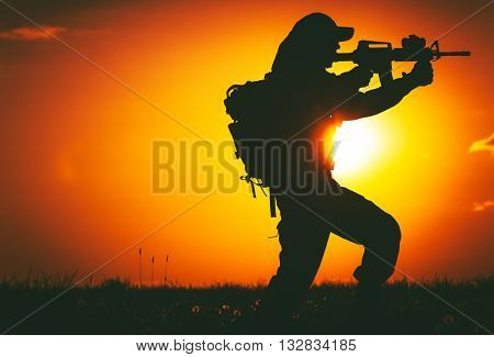 Army Trooper with Assault Rifle in Mission. Military Mission at Sunset. Military Concept.