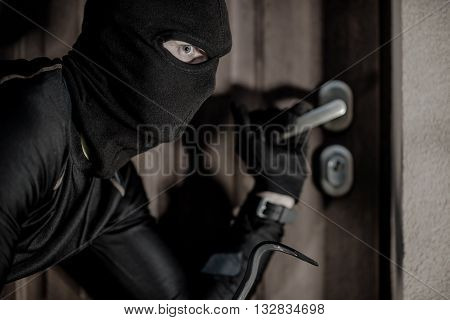 House Burglar in Mask Taking Action. Checking House Doors. House Burglary Concept.