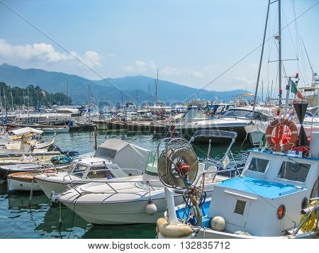 Santa Margherita Ligure, Liguria, Italy - circa June 2010: fishing boats, sailboats and motorboats in the port of one of the most popular resorts on Italian Ligurian coast in summer.