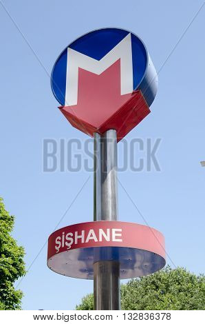 ISTANBUL TURKEY - JUNE 2 2016: sign for the Metro station in the fashionable Şişhane district of Istanbul on a sunny evening in June.