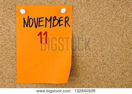 11 November Written On Orange Paper Note