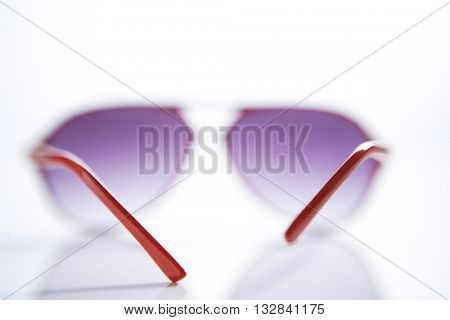 LOW DYNAMIC ANGLE ANGLE , BEAUTIFUL IMAGE OF SUNGLASSES , LANDSCAPE VIEW , ON WHITE BACKGROUND