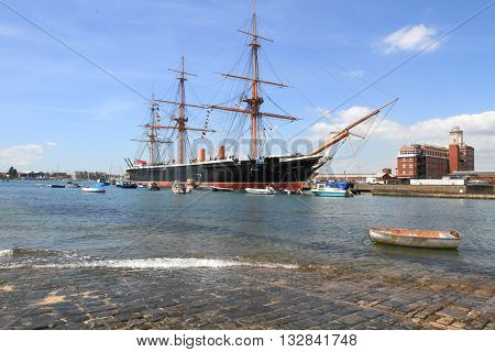 PORTSMOUTH, UK - JUNE 12, 2014: View of Portsmouth historical dockyard on June 12, 2014 in Portsmouth, UK. Historical warships of the UK royal navy are displayed in this landmark dockyard.