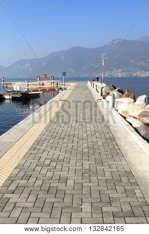 ISEO, ITALY - OCTOBER 31, 2014: Pier at Lake Iseo on October 31, 2014 in Iseo, Italy. Lake Iseo is the fourth largest lake in Lombardy and a popular tourist resort in Italy.
