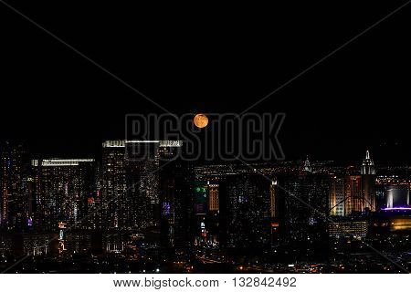 MAY 30, 2016 LAS VEGAS, NV -- View from The Palms Casino and Resort of the skyline of Las Vegas Strip with bright moon and views of Aria Casino on a dark night -- MAY 30, 2016 LAS VEGAS, NV