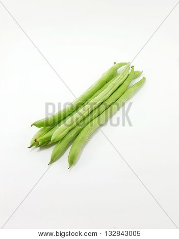 Whole fresh green beans on white background