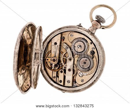 Vintage pocket watch with open rear lid isolated on white background.