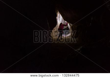Woman Caver Spelunker Exploring The Cave