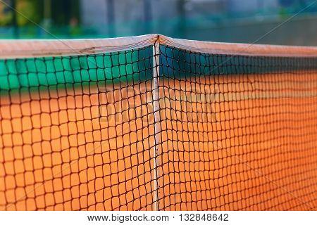 close up of tennis net, blur background