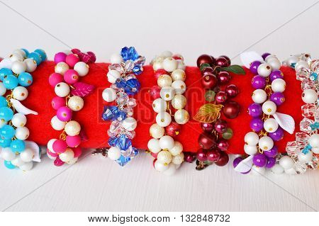 Set of bracelets. Beautiful colorful bracelets with plastic beads and leaves.