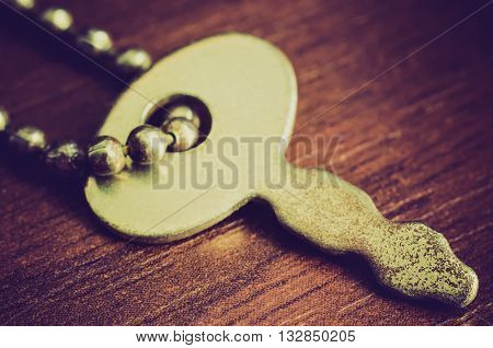 an old key on a chain macro