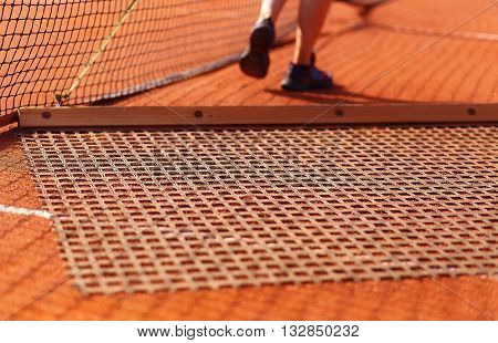 Aligning surface tennis court, with pulling network