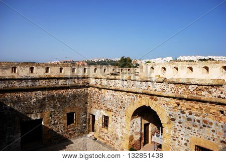 Elevated view of the castle courtyard with town buildings to the rear Duquesa Malaga Province Andalucia Spain Western Europe.