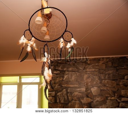 Dreamcatcher in home and abstract blur background