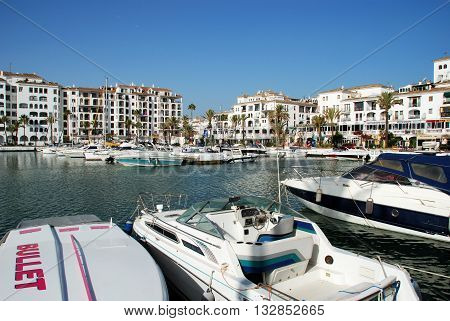 PUERTO DUQUESA, SPAIN - JULY 18, 2008 - Yachts and boats in the marina surrounded by apartments and restaurants Puerto Duquesa Malaga Province Andalucia Spain Western Europe, July 18, 2008.