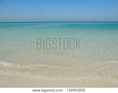 seaside beach sand blue sky coastline nature