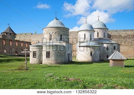 LENINGRAD REGION, RUSSIA - SEPTEMBER 27, 2015: Ancient churches of Ivangorod fortress, sunny september day. Religious landmark of the Leningrad region, Russia