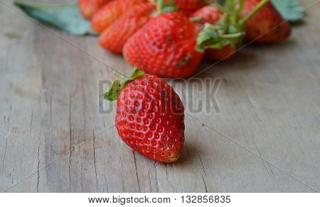 strawberry berry fruit on the wooden board