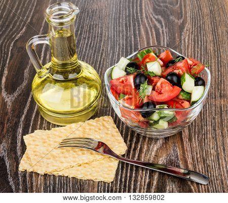 Vegetable Salad, Bottle Of Oil And Crispbread On Table