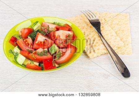 Vegetable Salad, Fork And Crispbread On Table