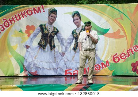 Kazan Republic of Tatarstan Russia - May 28 2016: Sabantuy ( translated from Tatar - feast of the plow) is a traditional celebration of the end of spring field work. Khamzin Almaz - honoured art worker of the Republic of Tatarstan singer entertainer produ