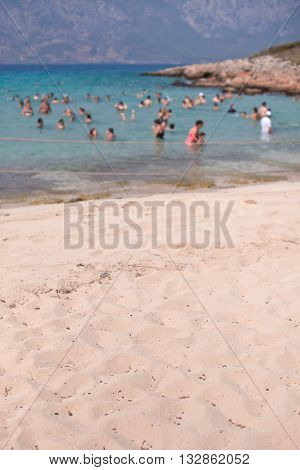 People swim in the sea. Cleopatra's Beach on the island of Sedir. Turkey. Blurred.