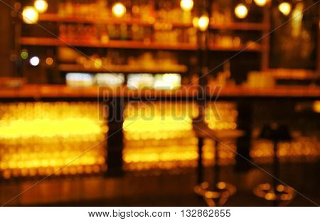 blur stools at counter in bar and restaurant for hanging at dark night
