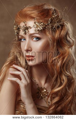 Beautiful woman red hair professional make-up gold color golden jewelery beauty pure skin model close-up portrait .