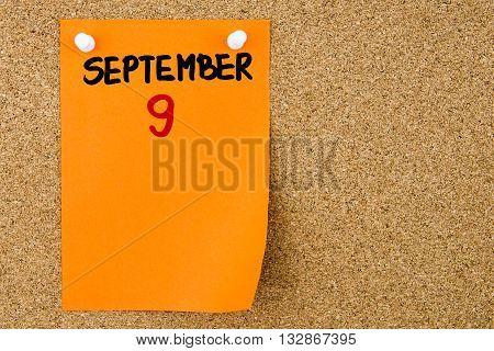 9 September Written On Orange Paper Note