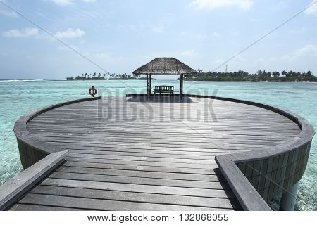 Wood  round jetty bridge in clear blue tropical wate