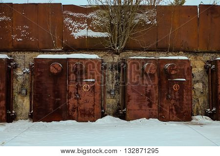 Nuclear bunker. Nuclear bomb shelter. Old abandoned Soviet Cold War bunker in forest. Locked steel gate with ventilation vents.
