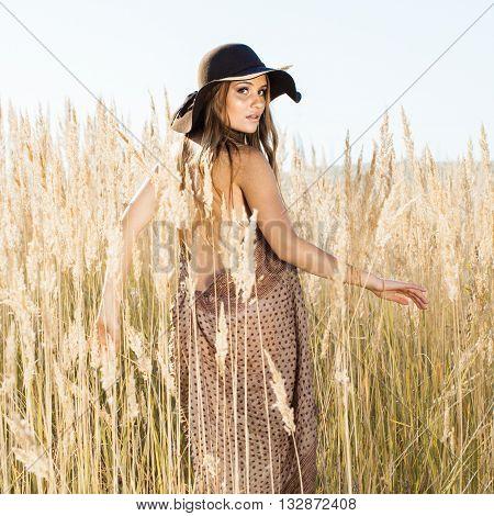 Beautiful Model Making Her Way Through Tallgrass Meadow