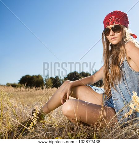 Hippie Girl Sitting On A Meadow - Morning Shot