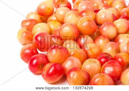 a lot of yellow cherries isolated on white background.