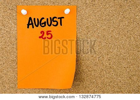 25 August Written On Orange Paper Note