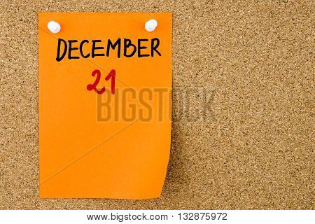 21 December Written On Orange Paper Note