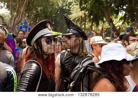 Members Of  Pride Parade Surrounded By Other People