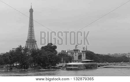 Paris; France-June 04 2016 : The Eiffel tower and Seine river in flood near bridge Alexandre III.The river Seine in Paris is at his highest level for more than 30 years with floods forcing closed parts of the metro systems and major landmarks.