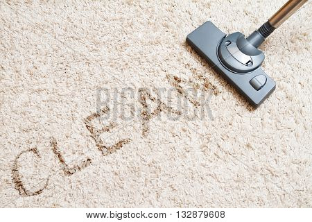 include the long beige carpet cleaning with a vacuum cleaner