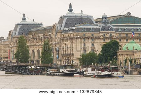 Paris; France-June 04 2016 : The Orsay museum and Seine river in flood .The river Seine in Paris is at his highest level for more than 30 years with floods forcing closed parts of the metro systems and major landmarks.