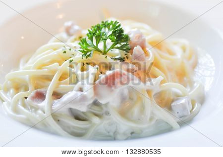 carbonara spaghetti with ham dish on the table