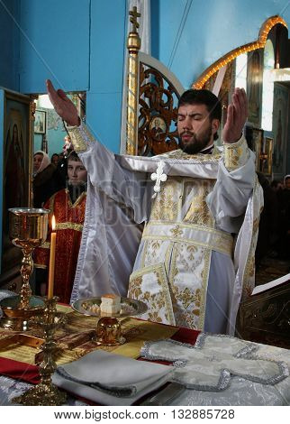 LUTSK UKRAINE - JANUARY 08 - Priest consecrates bread during orthodox liturgy ceremony in Lutsk on January 08 2009.