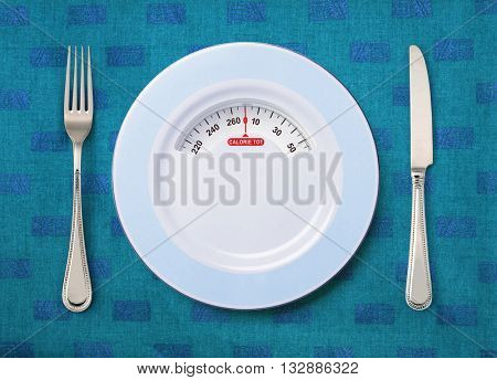 tableware and plate with weighing scale on the table