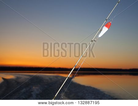Twilight fishing rod and lure on a lake in Saskatchewan Canada