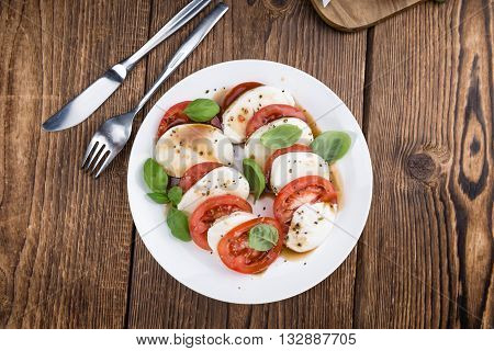 Portion Of Mozarella With Tomatoes And Balsamico Dressing