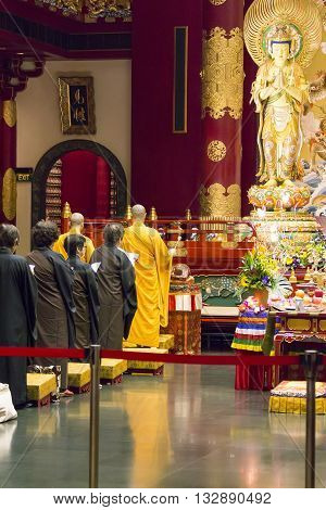 SINGAPORE - AUGUST 6, 2014: Unidentified people at Buddha Tooth Relic Temple in Singapore. The temple was opened at 2007 and become a popular attraction within Singapore Chinatown.