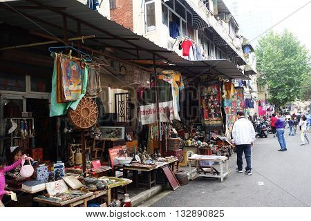 SHANGHAI CHINA- JUN 04 2016: Dongtai Lu Antique Market typical shops. The market is great for mementos and souvenirs of Shanghai China